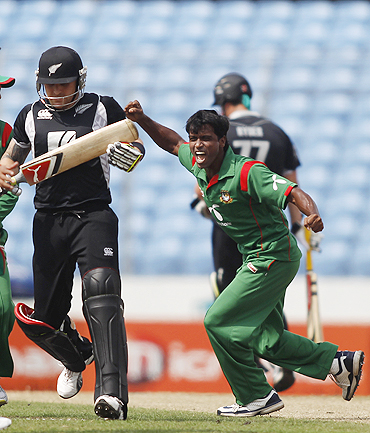 Bangladesh's Rubel Hossain (right) celebrates after dismissing New Zealand's Brendon McCullum during their fifth one-day international in Dhaka on Sunday