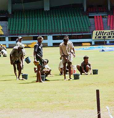 Groundstaff working at the Nehru Stadium in Kochi