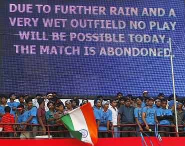 Spectators leave after the first ODI between India and Australia was called off