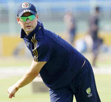 Australia's captain Michael Clarke throws a ball at a cricket practice session in Vishakhapatnam