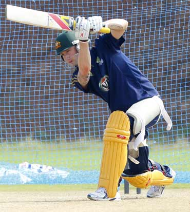 Australia's Tim Paine throws a ball at a cricket practice session in Vishakhapatnam