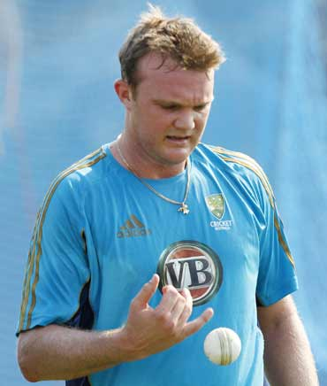 Australia's Doug Bollinger prepares to bowl at a cricket practice session in Vishakhapatnam