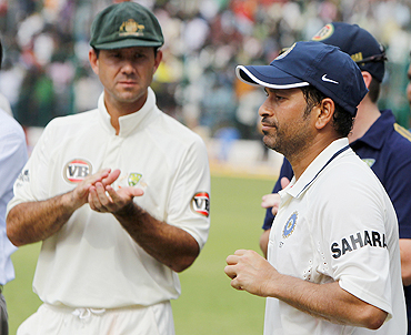 Ricky Ponting applauds as Sachin Tendulkar receives the Man-of-the-match award after the recently concluded Test series