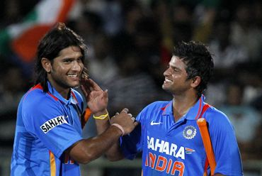 Saurabh Tiwary (L) and Suresh Raina at the end of the second ODI