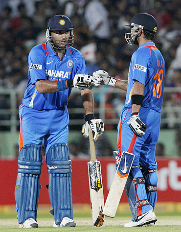 Yuvraj Singh (left) with Virat Kohli