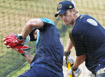 Australia's Tim Paine (left) takes a catch as teammate Cameron White looks on during a practice session in Margao on Saturday