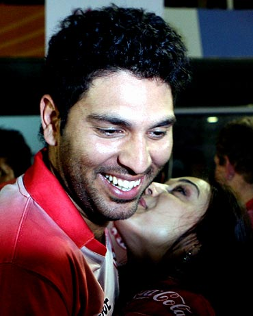 Kings XI Punjab player Yuvraj Singh gets a hug from co-owner Preity Zinta