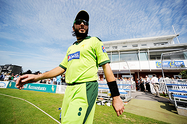 Pakistan ODI captain Shahid Afridi walks onto the field before the match against Somerset on Thursday
