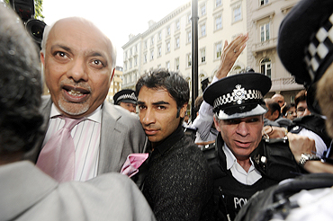 Pakistani cricketer Salman Butt (centre) arrives at the Pakistan High Commission in London on Wednesday