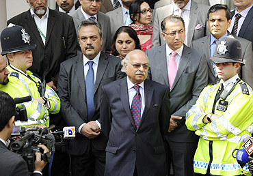 Pakistan's High Commissioner to Britain, Wajid Shamsul Hasan, speaks to the media outside the Pakistan high commission in London on Wednesday