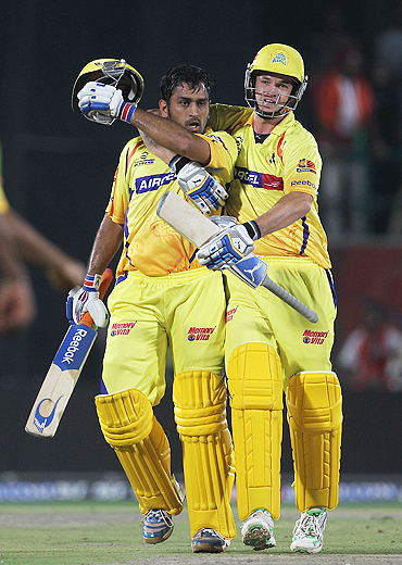 Chennai Super Kings' captain Mahendra Singh Dhoni (left) with teammate Albie Morkel