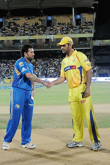 Sachin Tendulkar (left) greets Mahendra Singh Dhoni