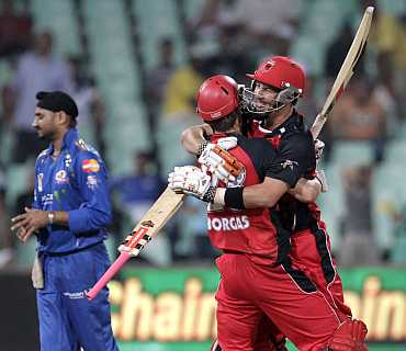 South Australian Redbacks' Borgas and Cooper celebrate after winning against Mumbai Indians in Durban