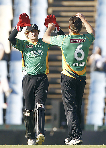 Central District's Doug Bracewell and Tim Weston (left) celebrate after dismissing David Hussey