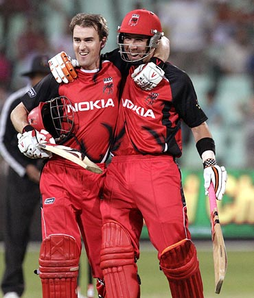 South Australian Redbacks' Cameron Borgas (left) and Tom Cooper celebrate winning their match against the Mumbai Indians