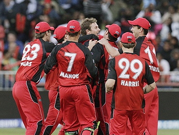 South Australian Redback's players celebrate the wicket of Robin Uthappa