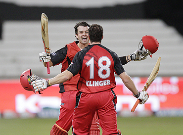 South Australian Redbacks' Callum Ferguson and Michael Klinger celebrate after winning their match against the Royal Challengers Bangalore