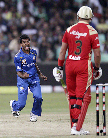 Mumbai Indians' Abu Nechim (left) reacts after claiming the wicket of Royal Challengers Bangalore's Jacques Kallis