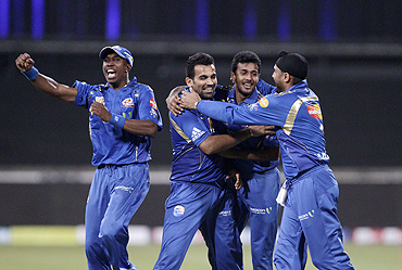Mumbai Indians' players celebrate after beating Royal Challengers Bangalore