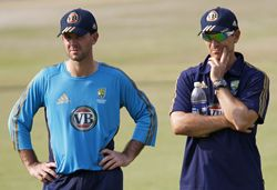 Ponting and batting coach Justin Langer watch Australia's net session on Friday