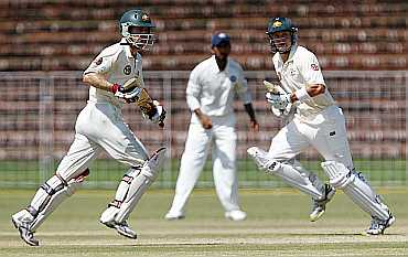 Simon Katich and Shane Watson take run during their tour match in Chandigarh