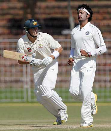 Shane Watson takes a run as Sreesanth looks on