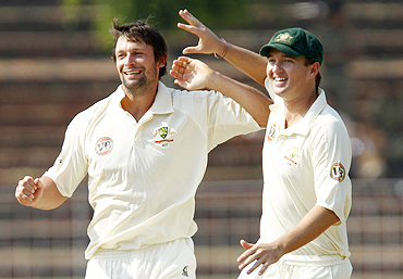 Australia's Ben Hilfenhaus (left) celebrates with teammate Nathan Hauritz after dismissing Ajinkya Rahane