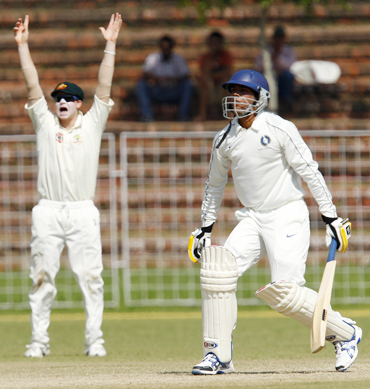 Australia's Steven Smith (left) unsuccessfully appeals for wicket of Pragyan Ojha