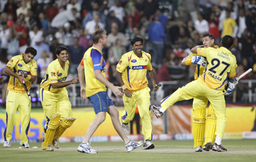 Chennai Super Kings players celebrate their win over the Warriors during their final Twenty20 cricket match in Johannesburg
