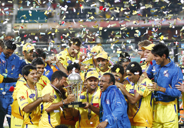 Chennai Super Kings players celebrate with the trophy after winning their final Twenty20 cricket match against the Warriors in Johannesburg