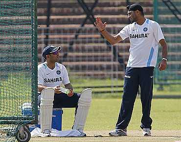 Harbhajan Singh speaks to Virender Sehwag during practice session in Mohali