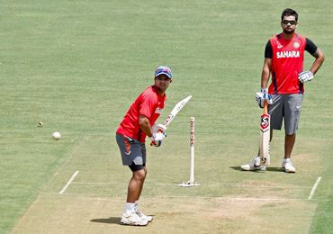 Suresh Raina and Virat Kohli practice at the Wankhede Stadium on Friday