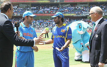 Dhoni (2nd from left) and Sangakkara (centre) agree a re-toss of the coin