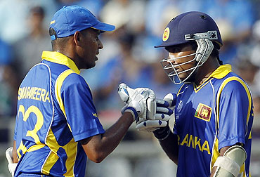 Mahela Jayawardene (right) is congratulated by Thilan Samaraweera after completing his 50