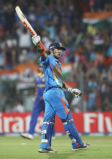 Gautam Gambhir of India celebrates reaching his fifty