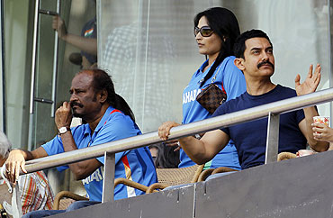 Actors Rajinikanth (left) and Aamir Khan (right) are seen in the gallery at the Wankhede stadium