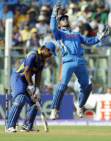 Mahendra Singh Dhoni celebrates after catching Kumar Sangakkara