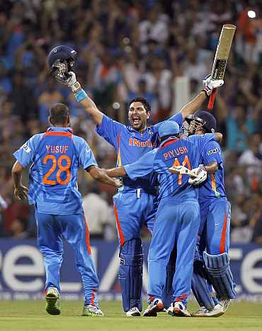 India's Yuvraj Singh celebrates with teammates after winning the World Cup against Sri Lanka in Mumbai