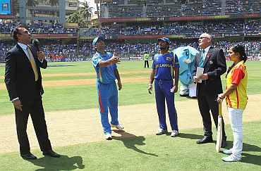 MS Dhoni spins the coin during the World Cup final against Sri Lanka
