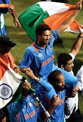 Tendulkar is chaired by teammates after the triumph