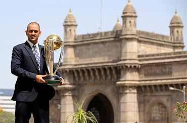 India's captain Dhoni lifts the trophy at the Taj hotel the day after India defeated Sri Lanka in the World Cup final in Mumbai