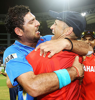 Yuvraj Singh celebrates with coach Gary Kirsten