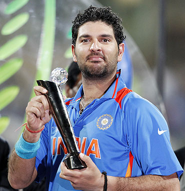 Yuvraj Singh celebrates with his Man of the Tournament trophy