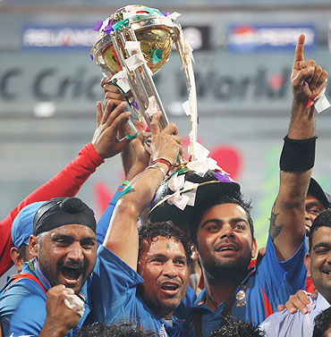 Sachin Tendulkar and Virat Kohli of India celebrate with the World Cup