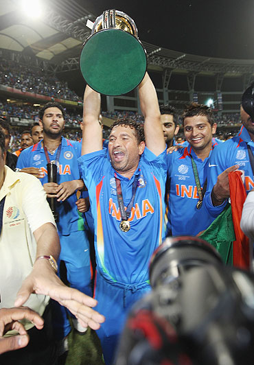 Sachin Tendulkar is chaired on a lap of honor after India's victory over Sri Lanka