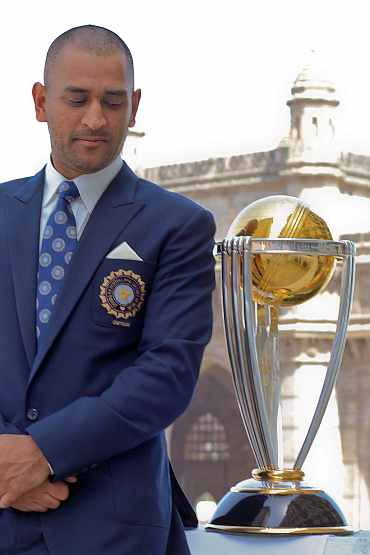 Indian captain MS Dhoni with the World Cup trophy