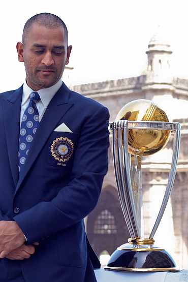 MS Dhoni with the World Cup trophy.