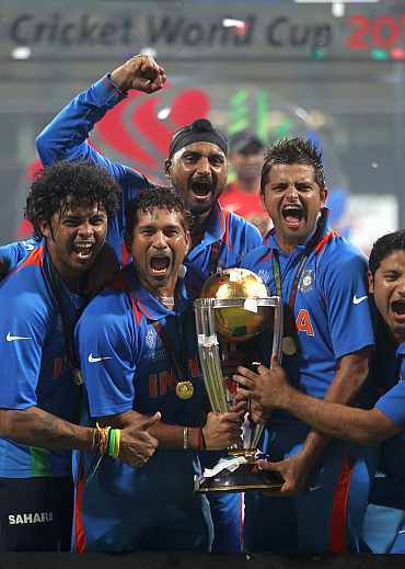 Indian team members celebrate after winning the World Cup.