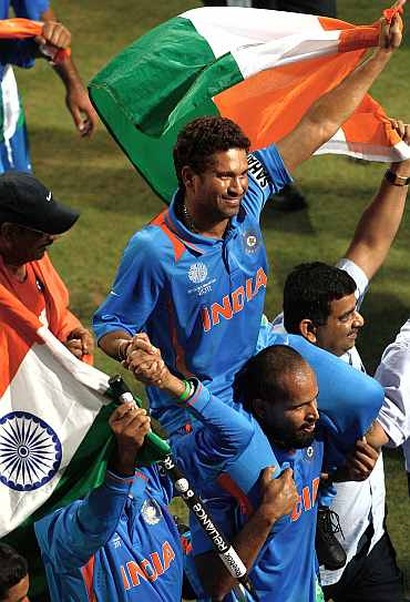 Sachin Tendulkar is chaired by his teammates on a lap of honour after the World Cup triumph