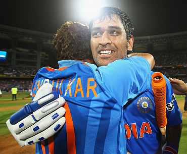 MS Dhoni celebrates after winning the World Cup match
